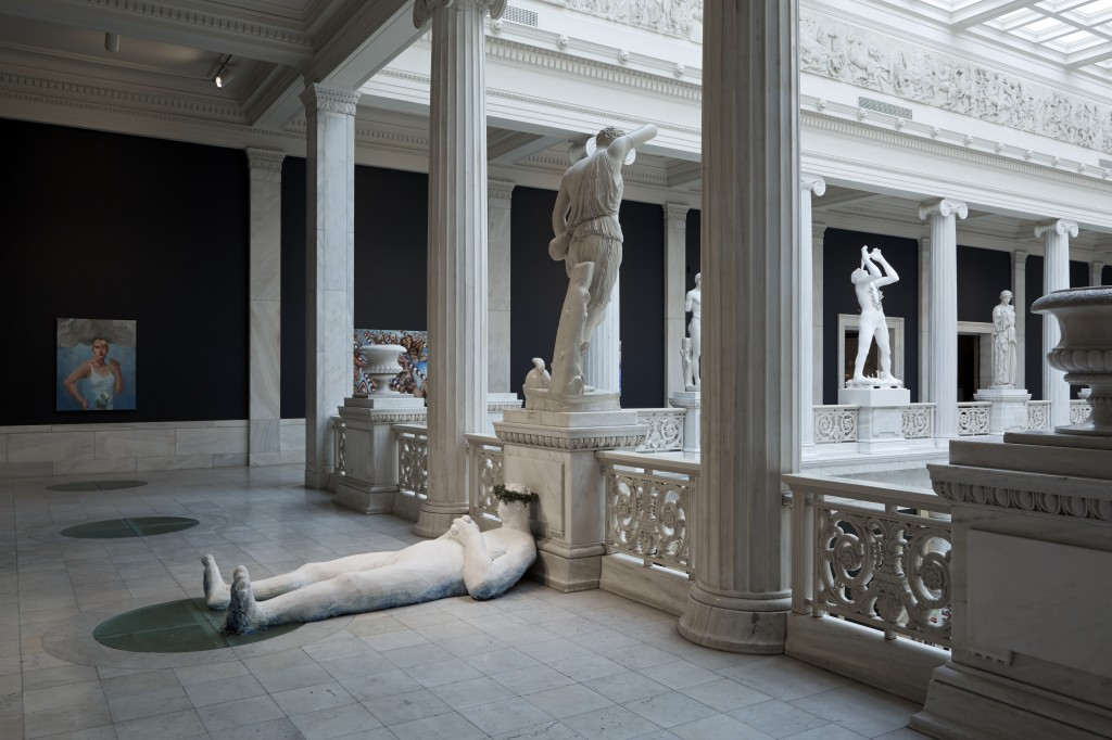 Installation view of Nicole Eisenman's paintings and sculptures in The Hall of Sculpture Balcony. Image courtesy of the Carnegie Museum of Art.