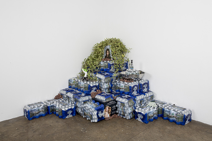 Carson Fisk-Vittori Glacier Mist, 2013. Bottled water, fountain, rotating display, ivy, lava rocks, hydro-spike, and other artifacts. 84 x 80 x 48 inches. Photo: Sara Condo. All images courtesy the artist and Carrie Secrist Gallery, Chicago.