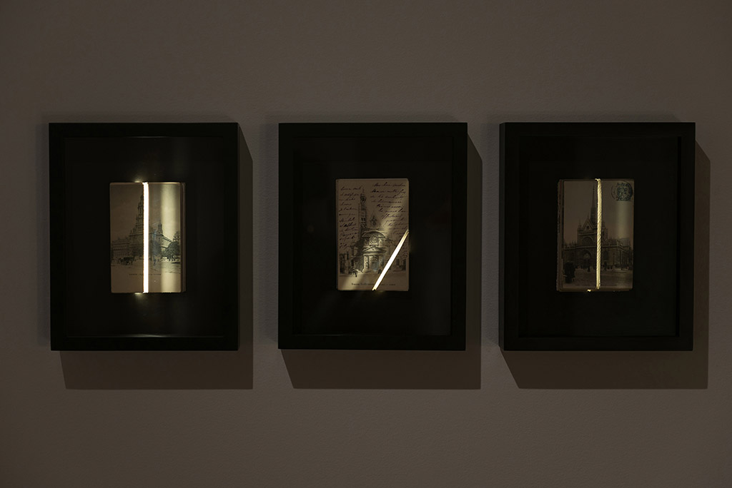 Projections, exhibition view, Yann Pocreau, 2013 © Maxime Boisvert Work: Traversée (St-Laurent church, de la Trinité church, St-Étienne-du-Mont church), 2013 Post cards, light boxes, saw cutting. 23 cm x 28 cm