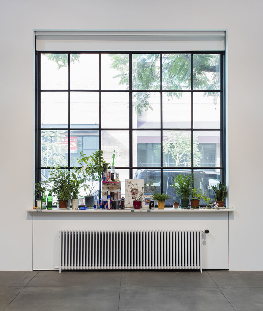 Untitled, 2016. Isa Genzken. Window, windowsill, radiator, plants, coins, aluminum cans, found objects. Dimensions variable. Courtesy the artist, Hauser & Wirth and Galerie Buchholz Cologne / Berlin / New York. © Artists Rights Society (ARS) New York / VG Bild-Kunst, Bonn. Photo: Brian Forrest