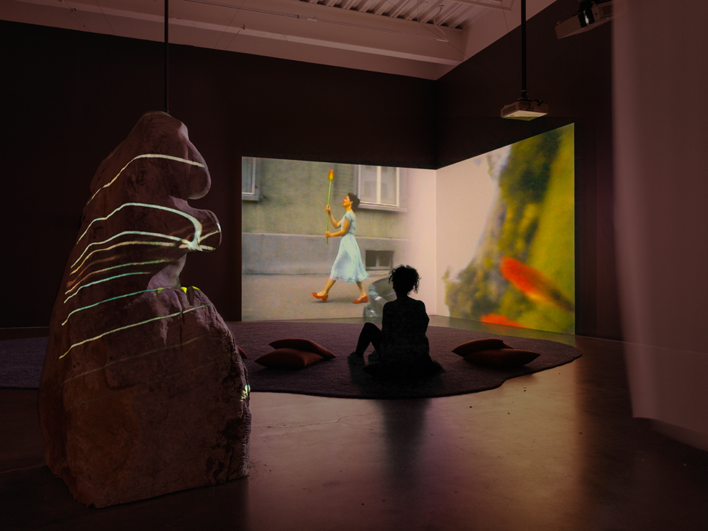 Pipilotti Rist, Ever Is Over All, 1997. Two-channel video and sound installation, color; 4:07 min. Dimensions variable. Sound by Anders Guggisberg and Rist. Courtesy the artist, Hauser & Wirth, and Luhring Augustine. Installation photo: Maris Hutchinson / EPW Studio, courtesy New Museum.