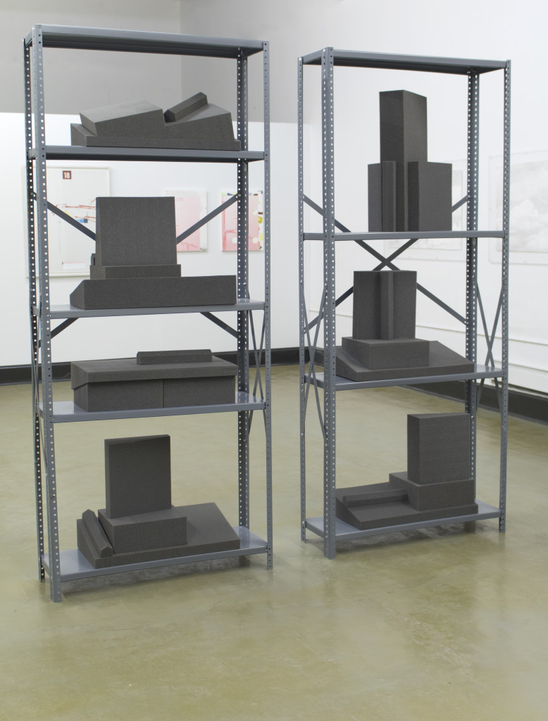 Jeff Prokash, Architectural Models / Foam Book Supports (Future Sites), Charcoal CV 1235 Medium 1200 Series Polyurethane Foam; February 20, 2017, 7 sets, 24 in x 12 in x 6 in (dimensions variable); Industrial Shelving; painted steel, zinc plated steel hardware, 2 sets 2 in x 36 in x 86 in, courtesy Phil Peters
