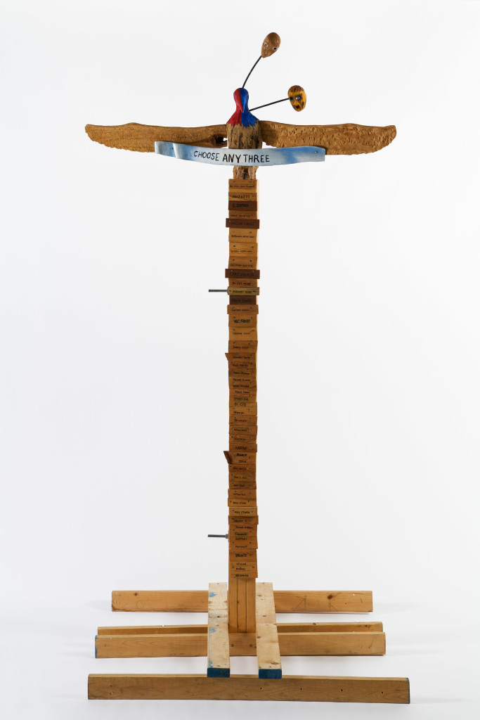 Jimmie Durham, Choose Any Three, 1989. Carved ash, magnolia, pine, metal, glass, acrylic paint. 99 ¼ × 49 ¼ × 48 in. (252 × 125 × 122 cm). Hammer Museum, Los Angeles. Purchased with partial funds provided by Susan Bay Nimoy and Leonard Nimoy. Image courtesy of kurimanzutto, Mexico City.