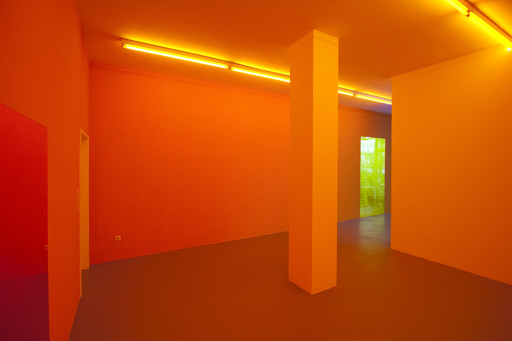 Gaylen Gerber, Kunstverein Ruhr, Essen, Germany, 2010. Installation view (left to right): latex paint, lighting gels, vinyl film, Gaylen Gerber, Support, n. d., Silver leaf, varnish on souvenir from Crossing Through the Colors, a work in situ, Daniel Buren (amber), 2006, 71.75 x 48 inches; Gaylen Gerber, Support, n. d., silver leaf, varnish on souvenir from Crossing Through the Colors, a work in situ, Daniel Buren (yellow), 2006, 94 x 48 inches. Photo: Gaylen Gerber.