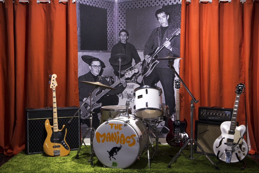 Photo of Kenneth Toineeta, Kevin Red Star, and Wallace Red Star, Jr. at Faux Stage with Instruments, Wendy Red Star: The Maniacs (We're Not The Best, But We're Better Than The Rest), University Art Gallery, New Mexico State University. Photo Courtesy of Mónica Martínez.