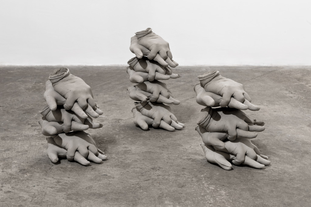 Ewa Axelrad, Minimum, Necessary, Objectively Reasonable #1, 2015. Stacks of life-size hands in a CPR position, concrete composite (dimensions variable).